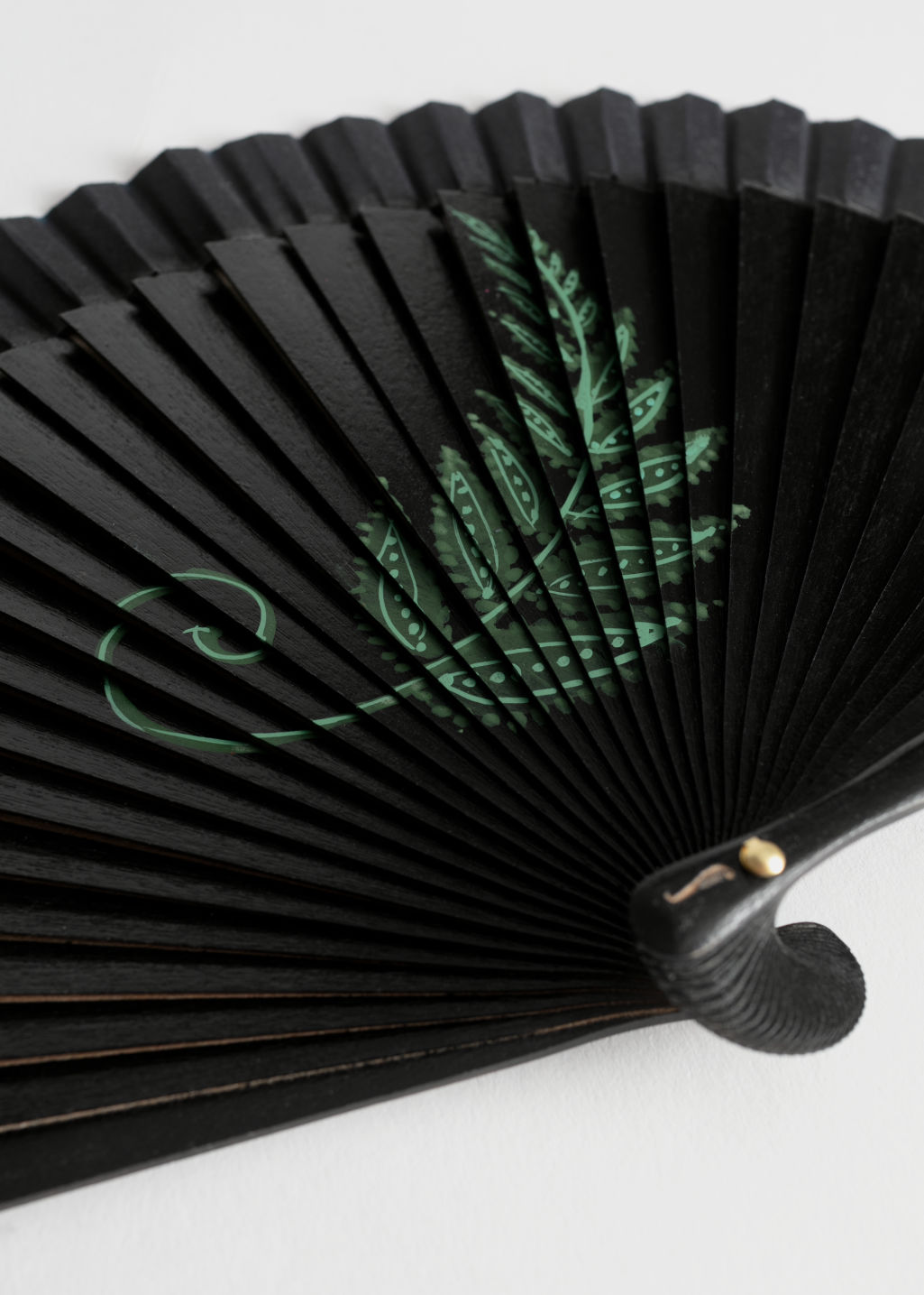 Back image of Stories wooden fern fan in black