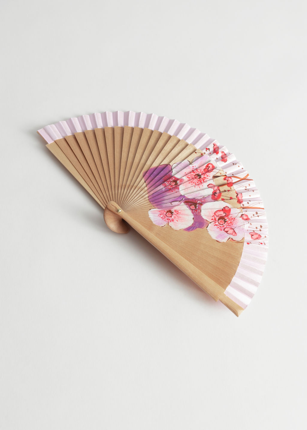 Front image of Stories wooden flower fan in pink