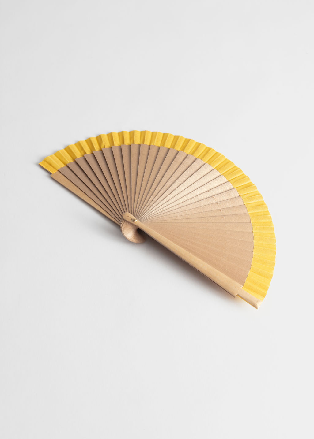 Front image of Stories wooden stripe fan in yellow