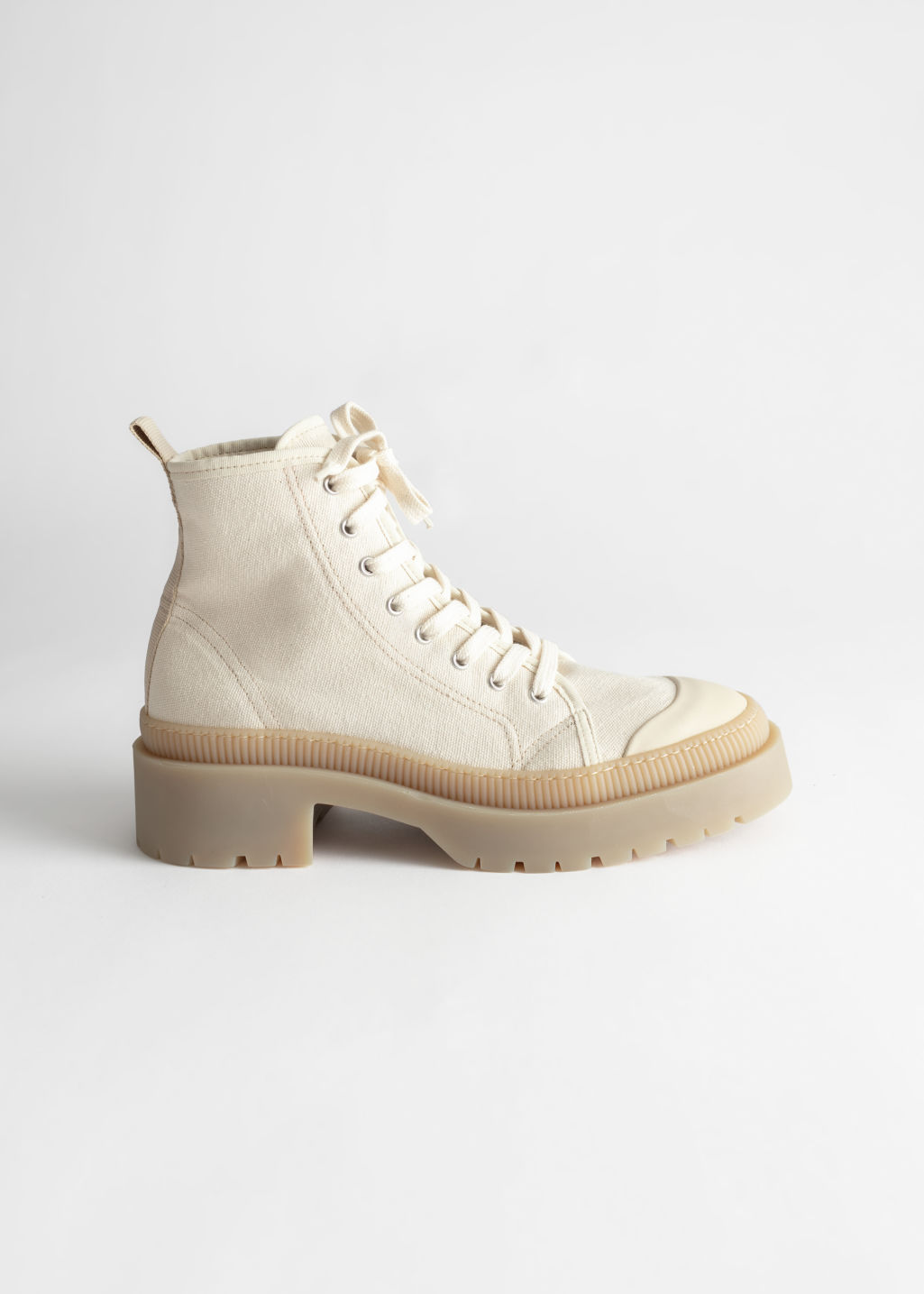 Front image of Stories canvas platform heeled boots in beige