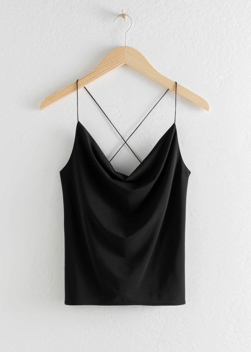 Front image of Stories draped cross back tank top in black