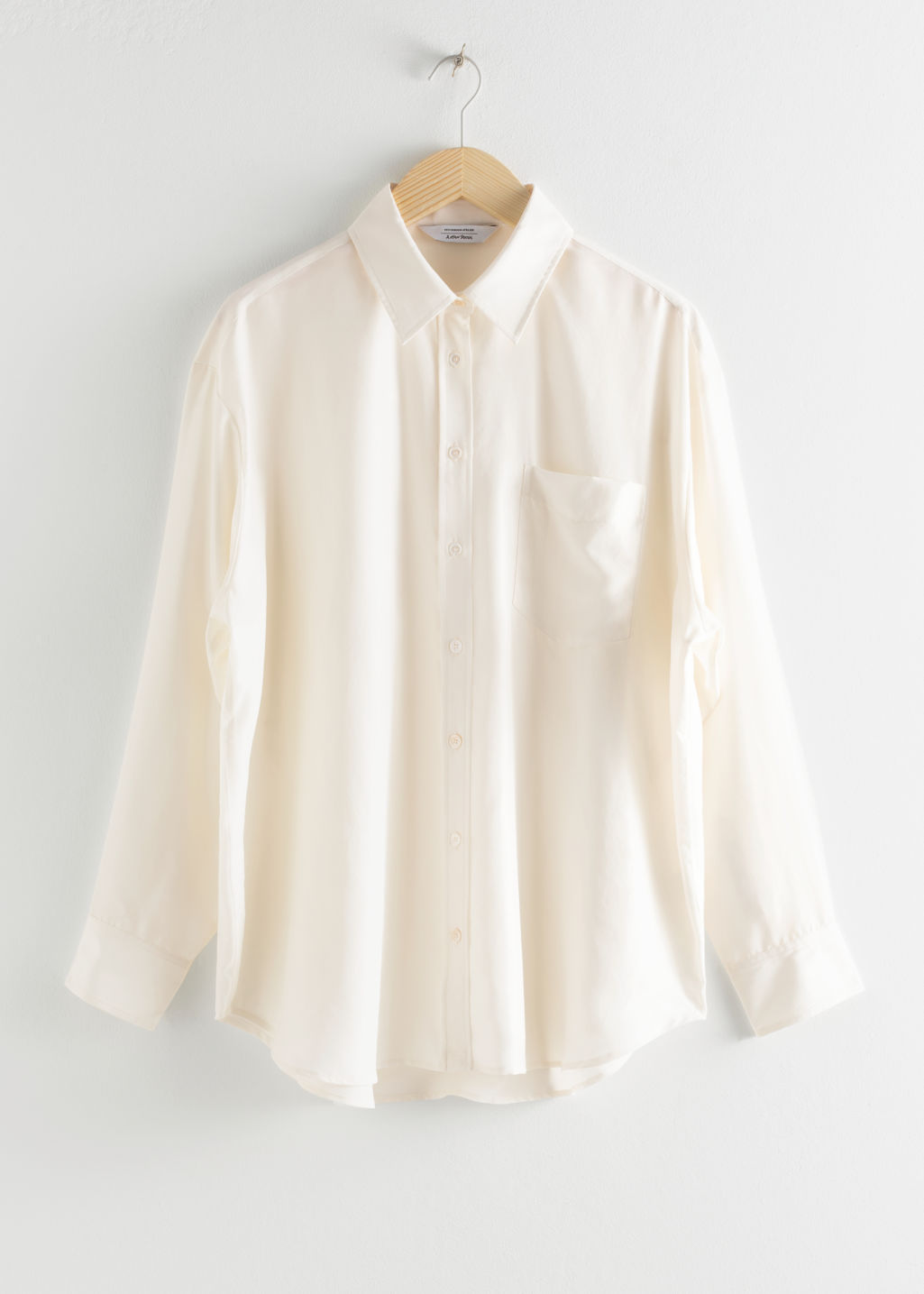Front image of Stories oversized silk shirt in white