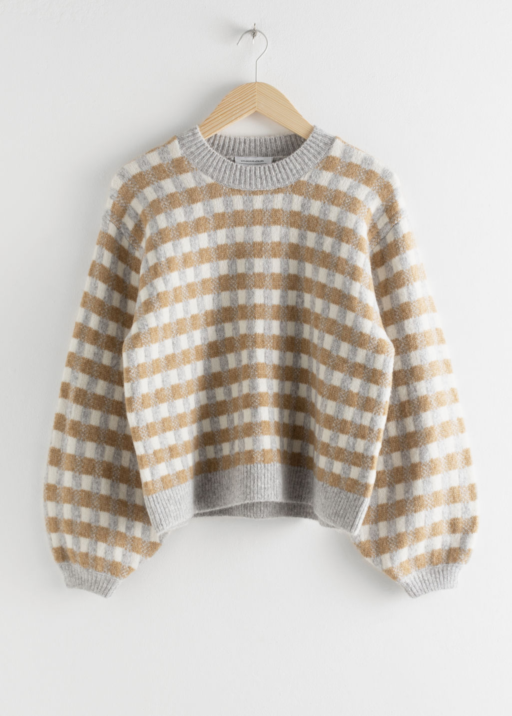 Front image of Stories puff sleeve check knit sweater in white
