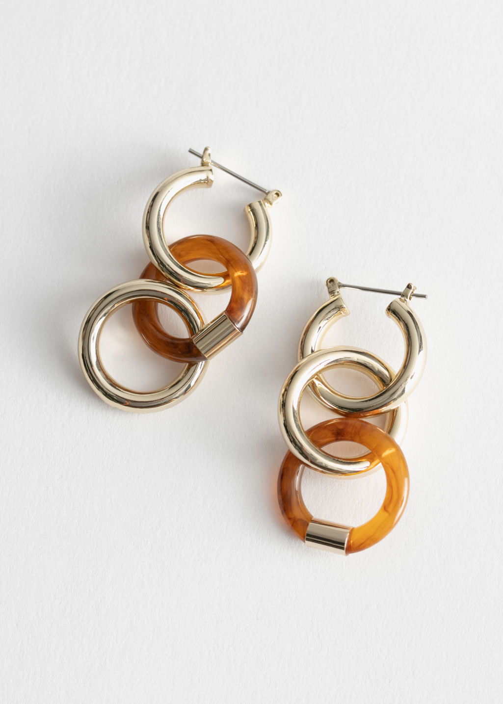 Front image of Stories trio hoop gold resin earrings  in red