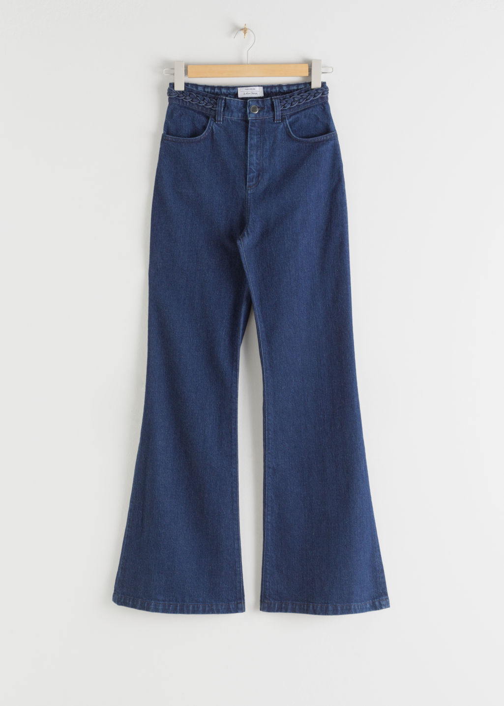 Front image of Stories kick flare braided waist jeans in blue