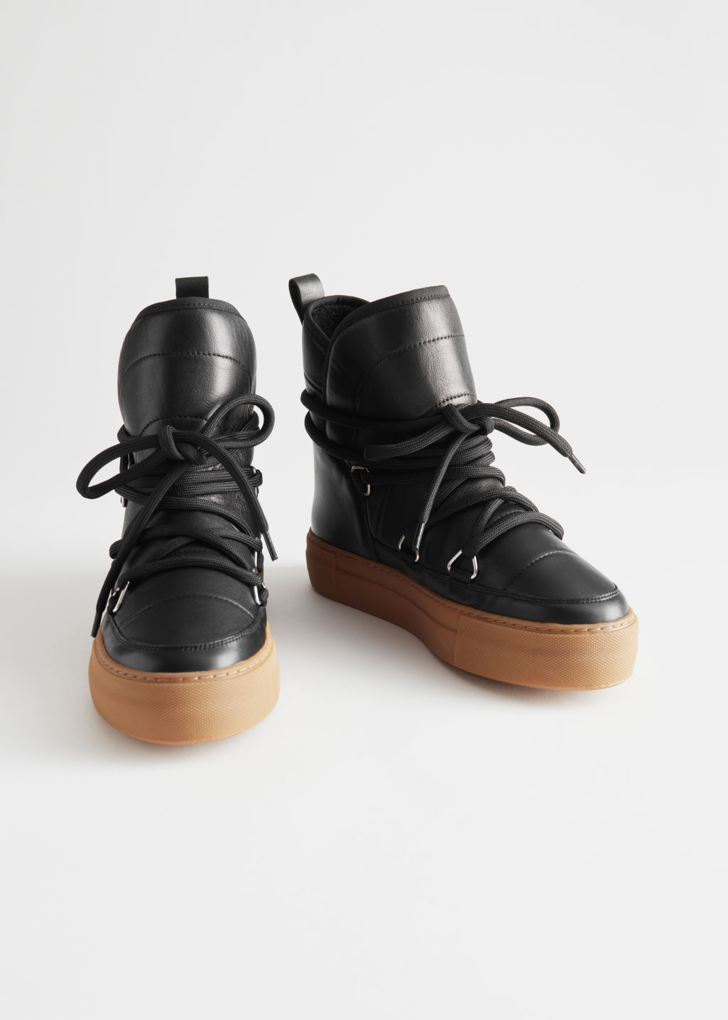 Front image of Stories shearling lined suede snow boots in black