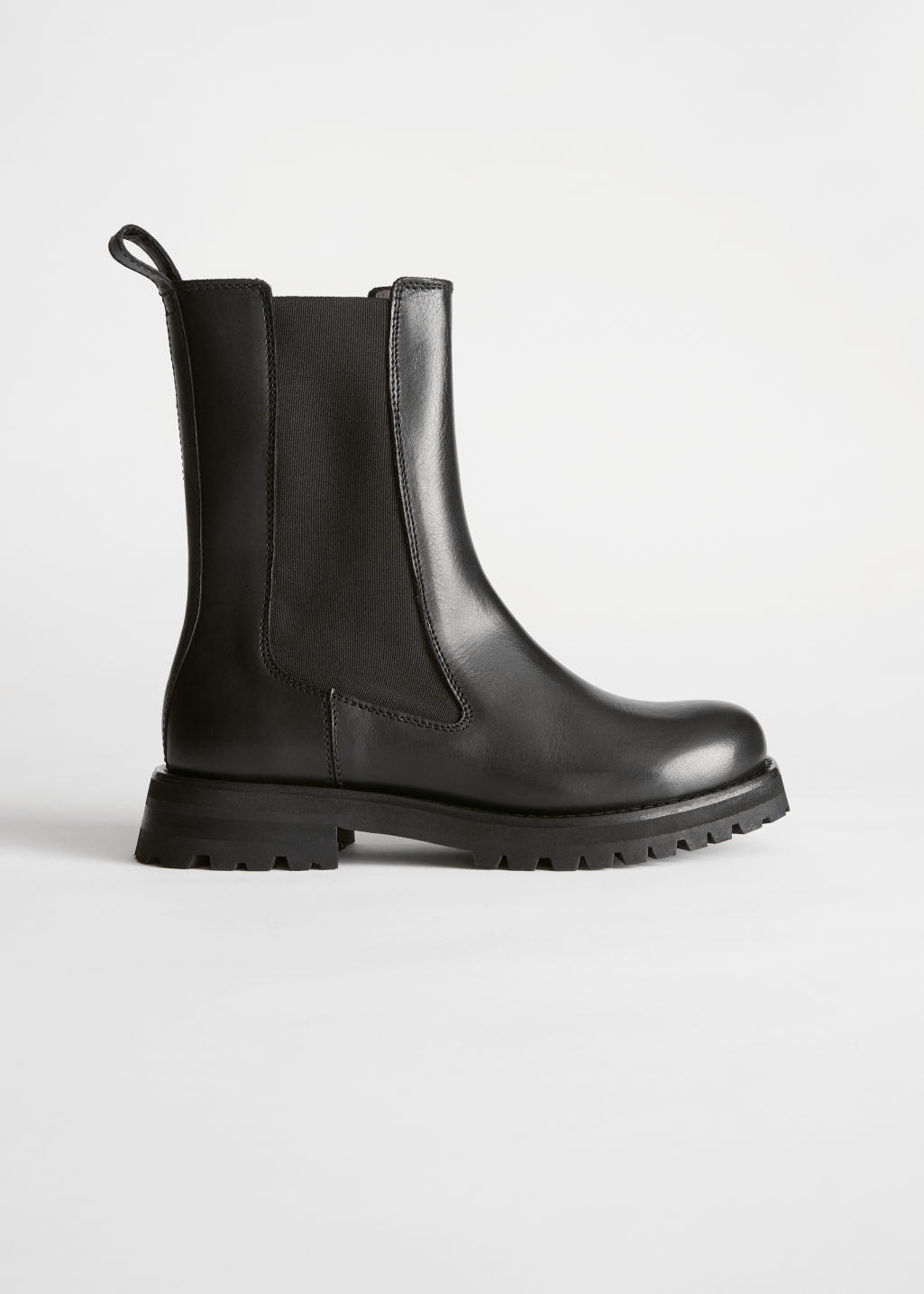 Side image of Stories chunky sole leather chelsea boots in black
