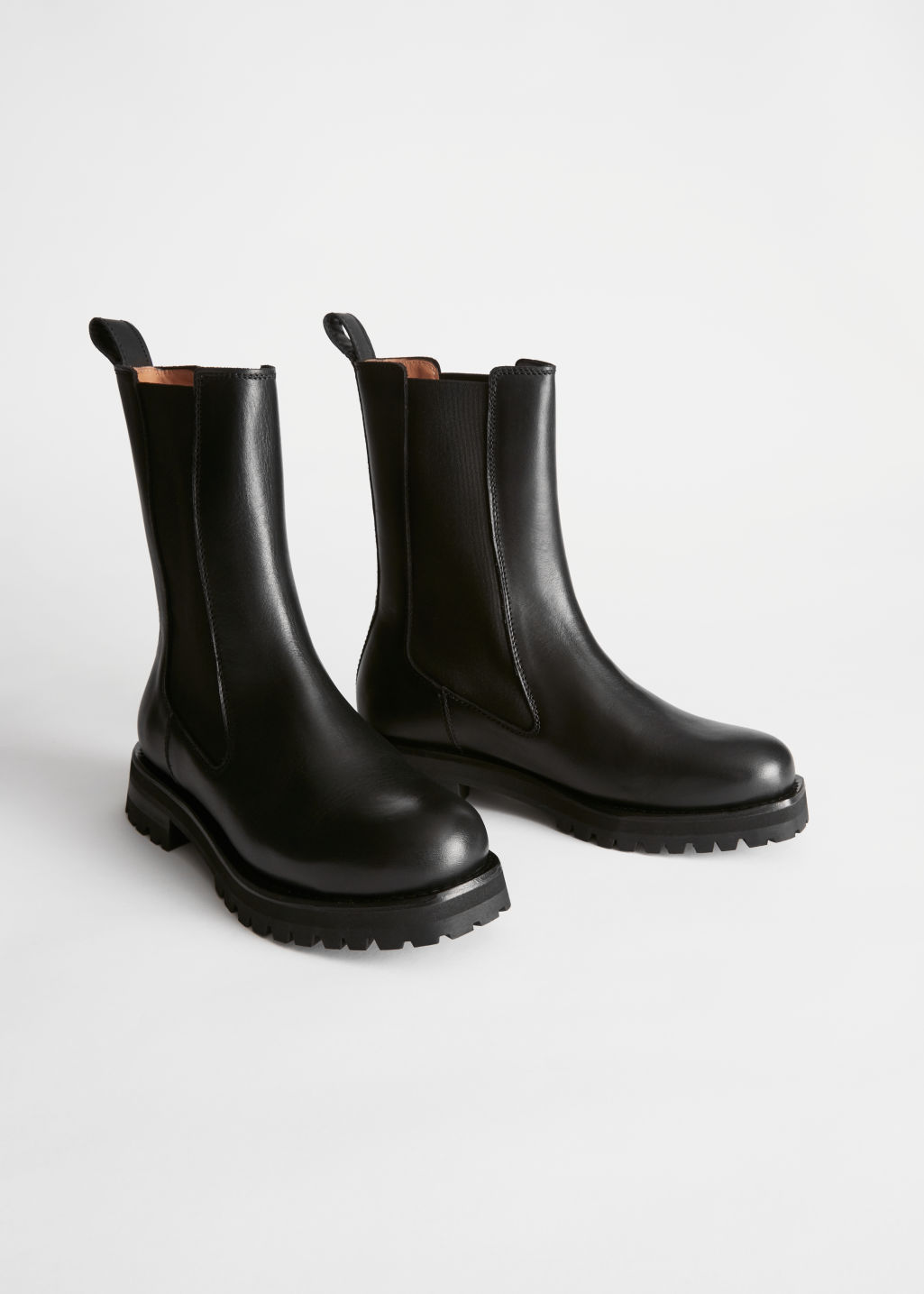 Front image of Stories chunky sole leather chelsea boots in black