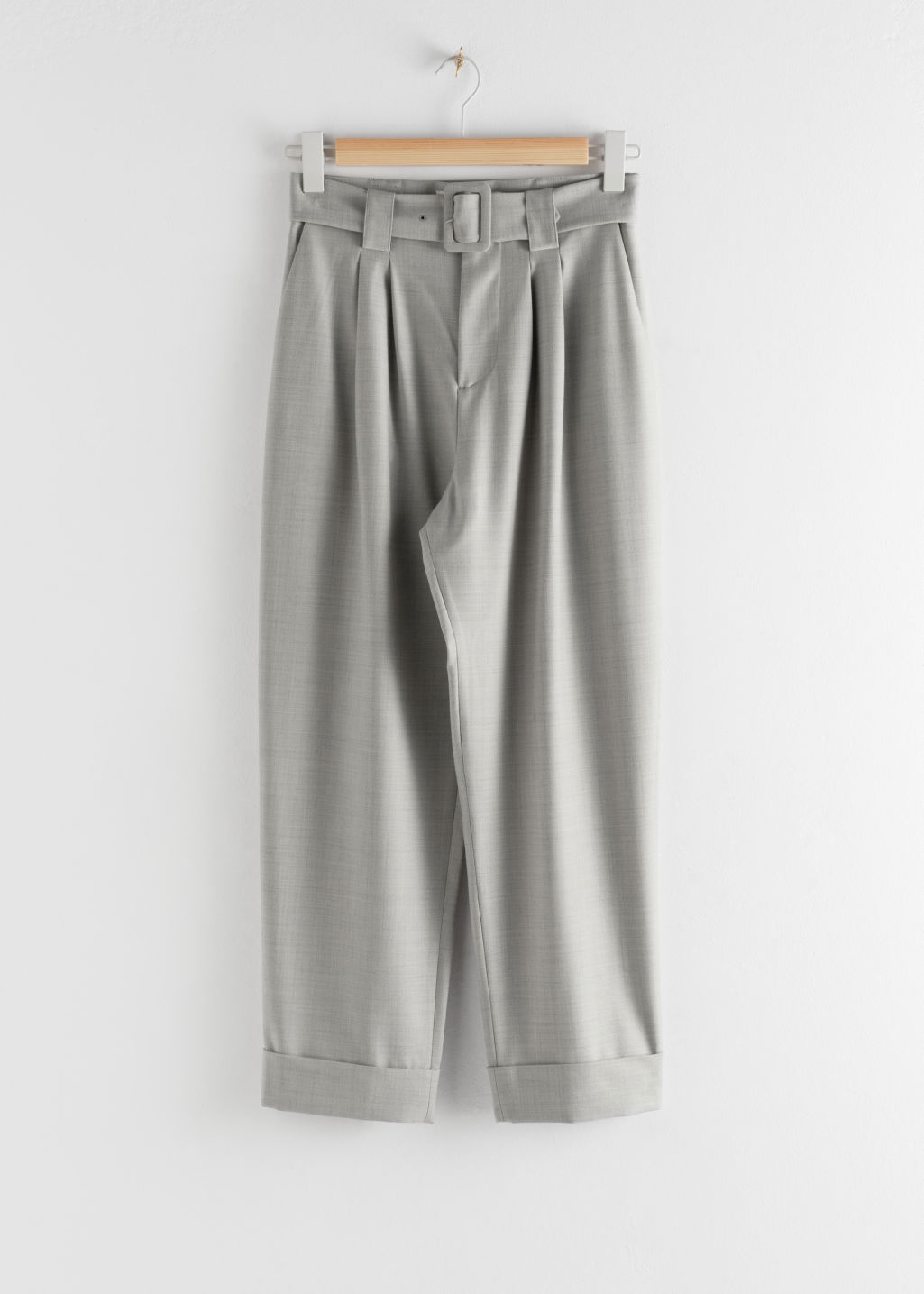 Front image of Stories pleated square buckle belted trousers in brown