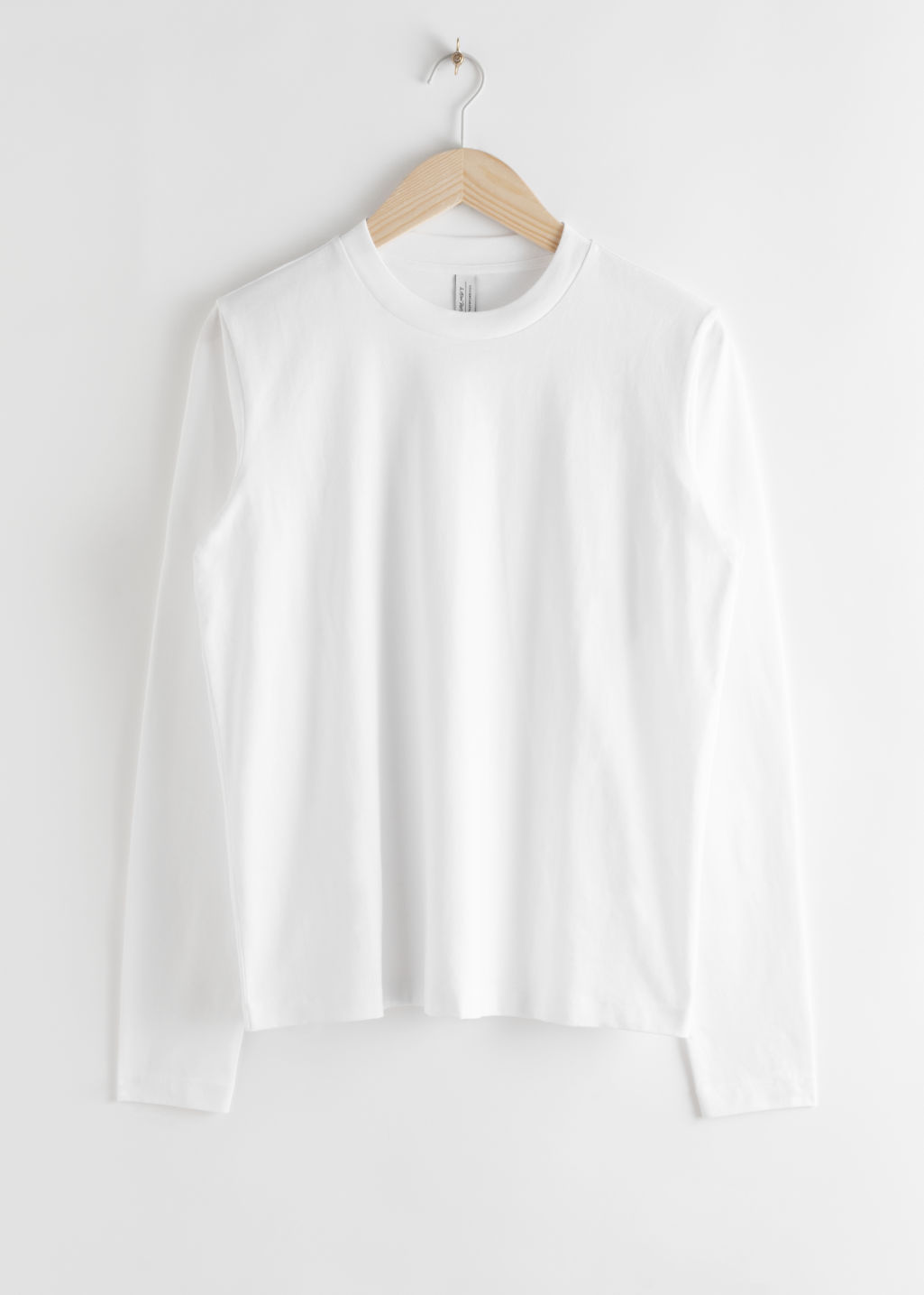 Front image of Stories organic cotton long sleeve t-shirt in white