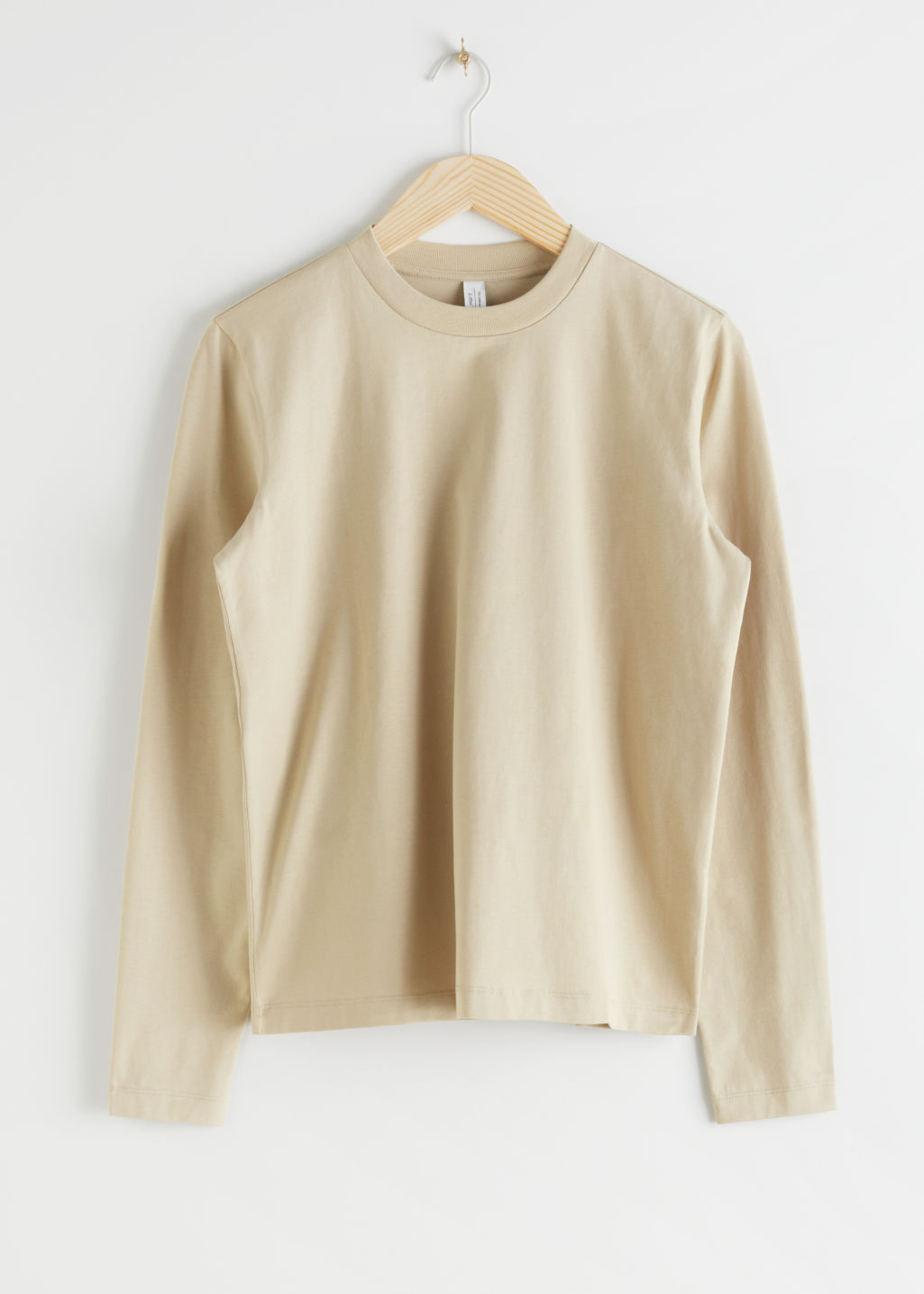 StillLife Front Image of Stories Organic Cotton Long Sleeve T-Shirt in Beige