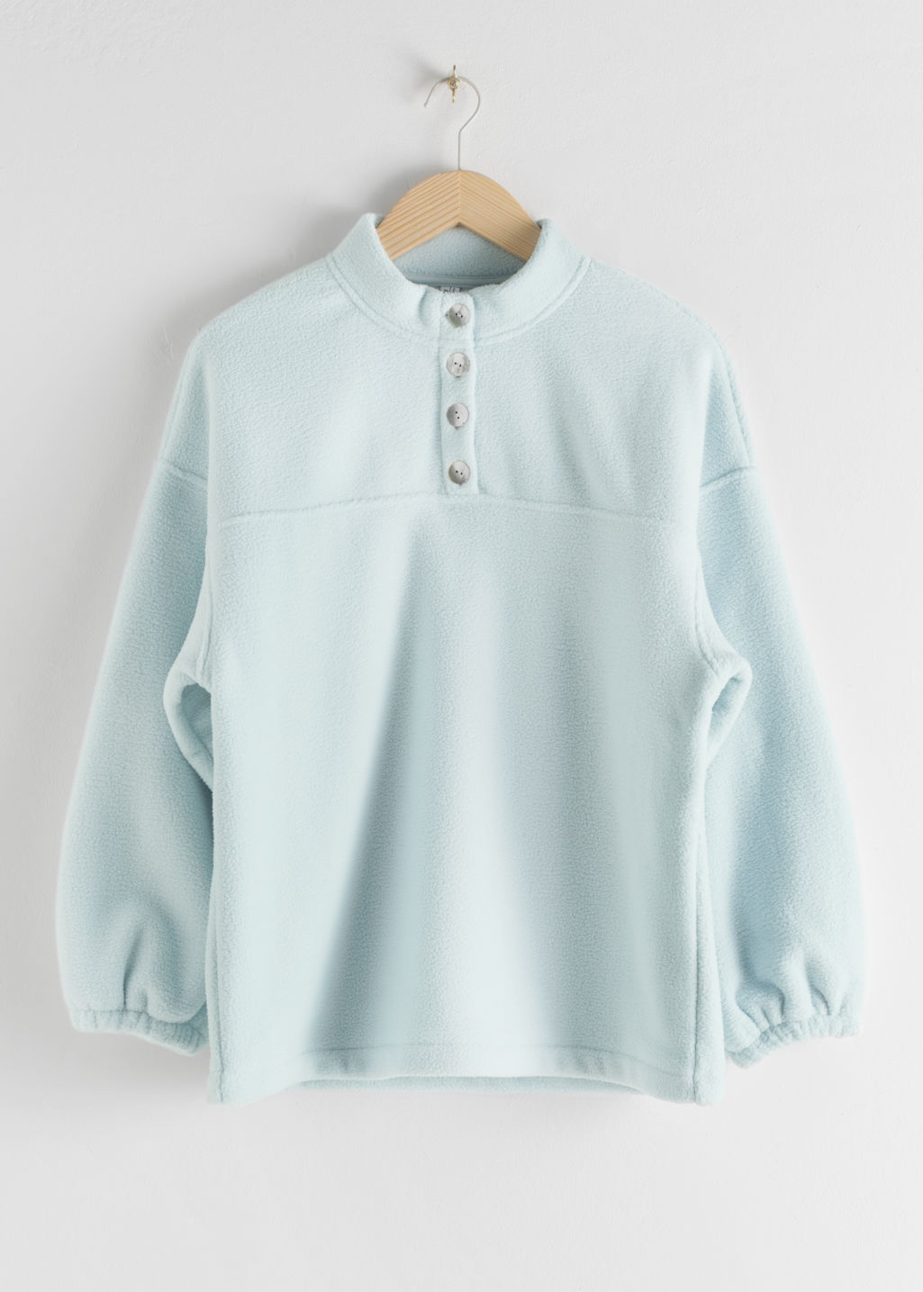 Front image of Stories fleece mock neck pullover in turquoise