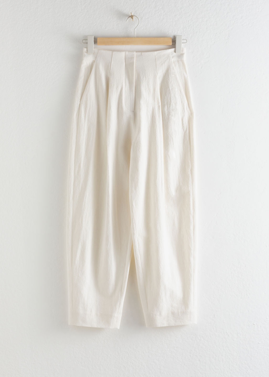 Front image of Stories linen blend relaxed crepe trousers in white