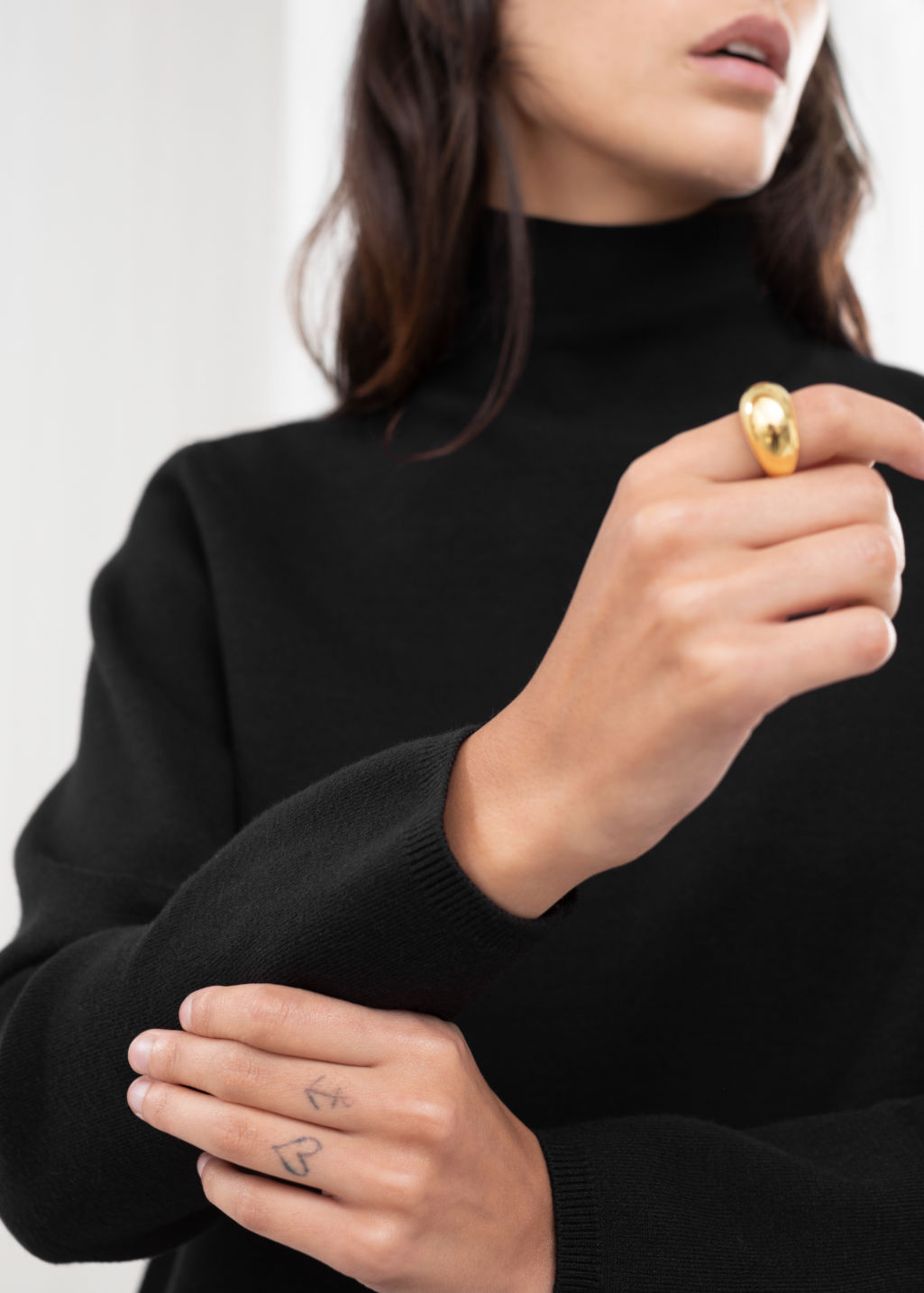 Front image of Stories glossy half sphere ring in gold