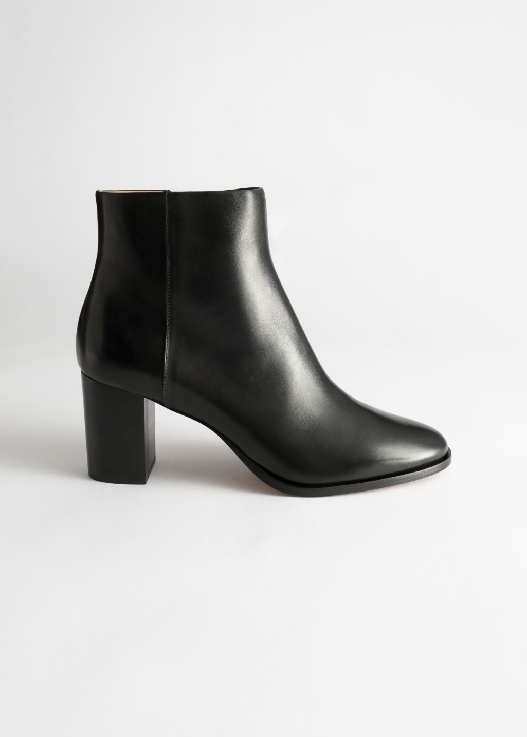 StillLife Front Image of Stories Chrome Free Tanned Leather Ankle Boots in Black