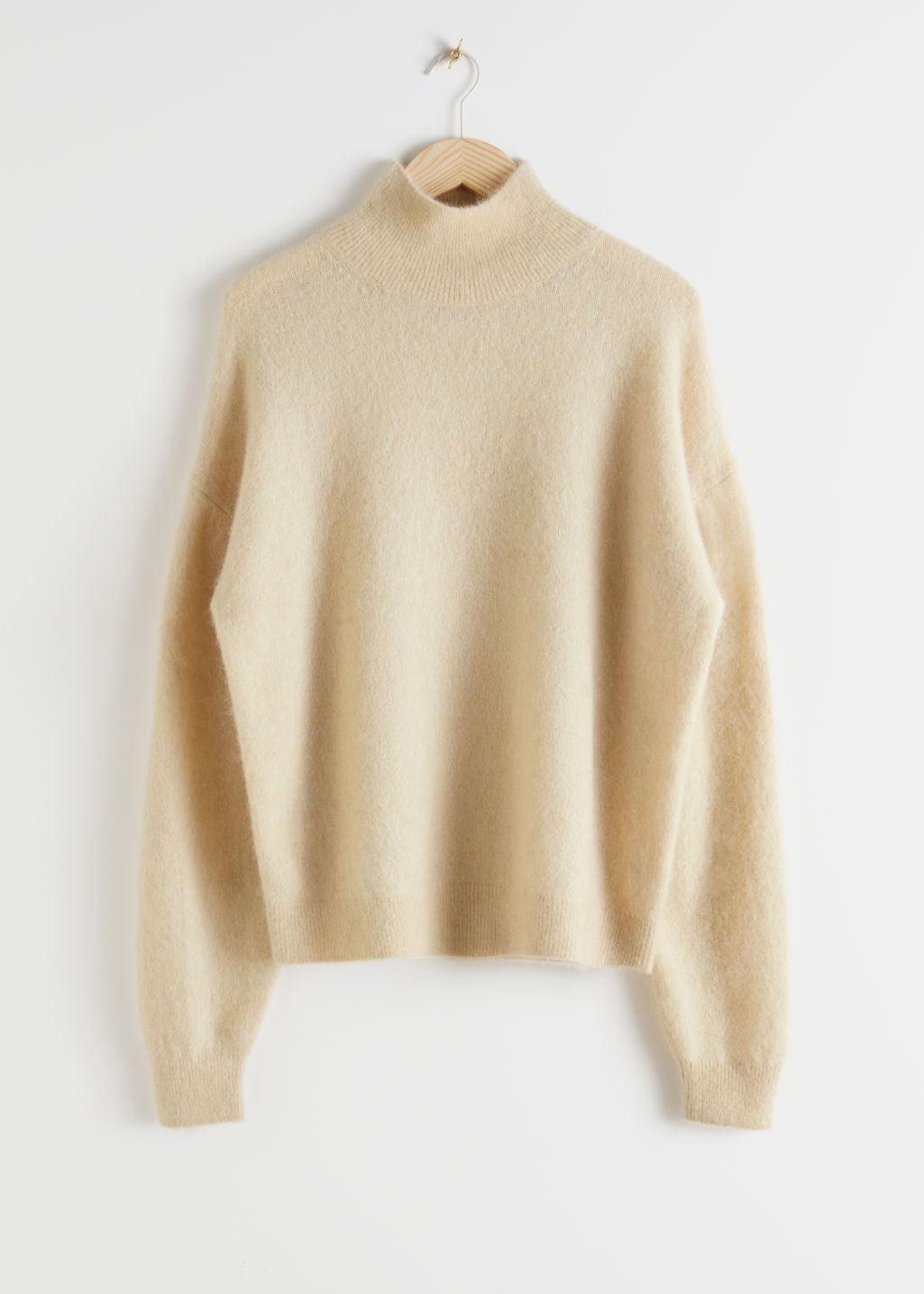 Front image of Stories alpaca blend mock neck sweater in beige