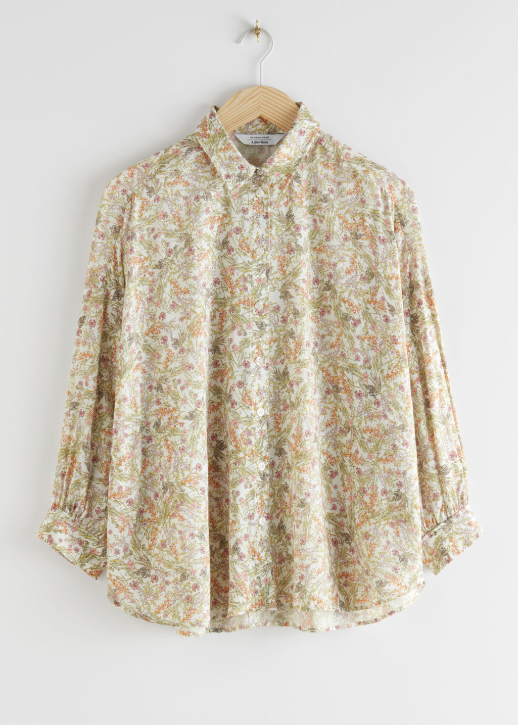 StillLife Front Image of Stories Semi Sheer Floral Print Blouse in White