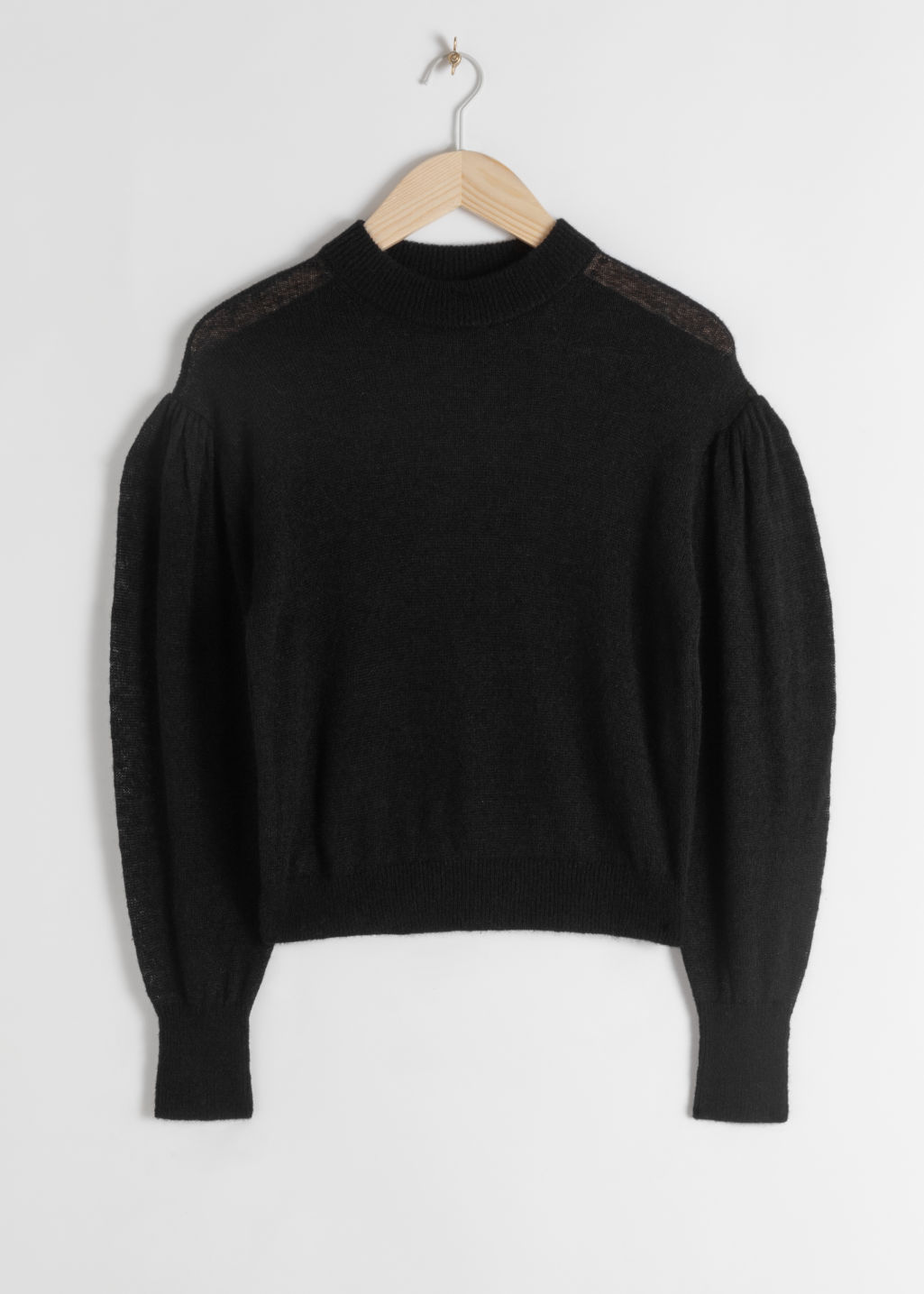 Front image of Stories wool blend puff sleeve sweater in black