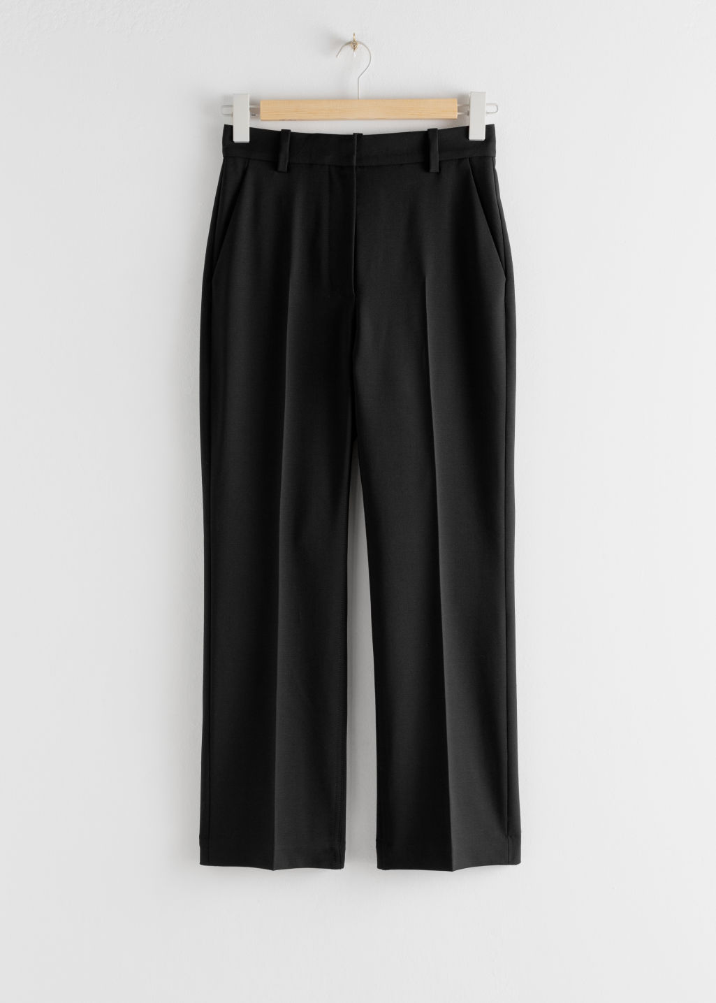 Front image of Stories wool blend kick flare trousers in black