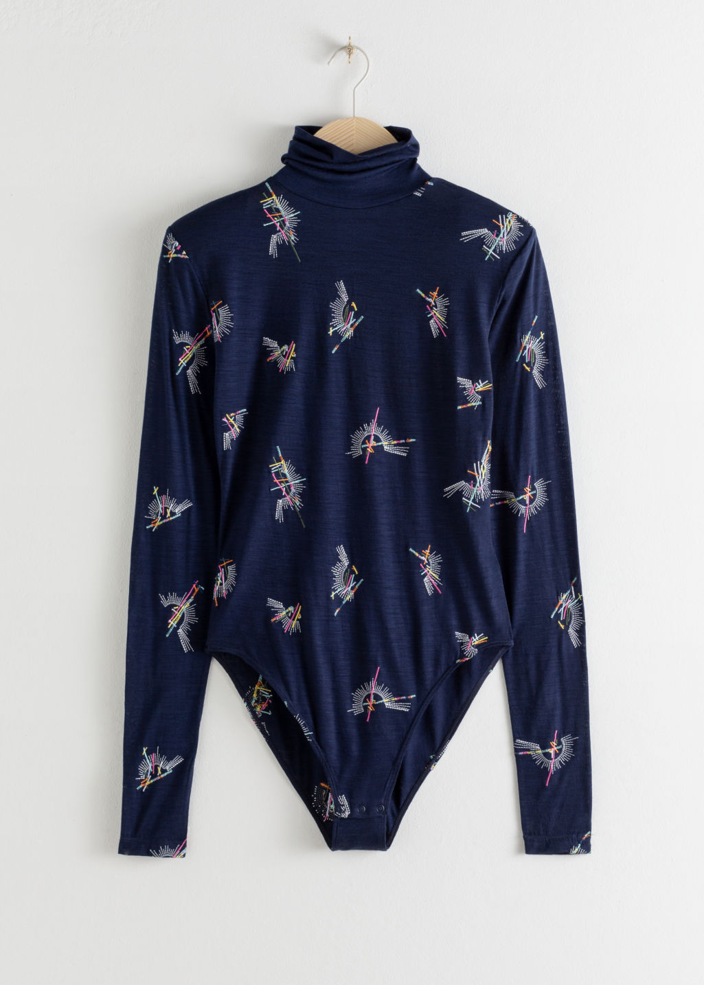 StillLife Front Image of Stories Embroidered Wool Turtleneck Bodysuit in Blue