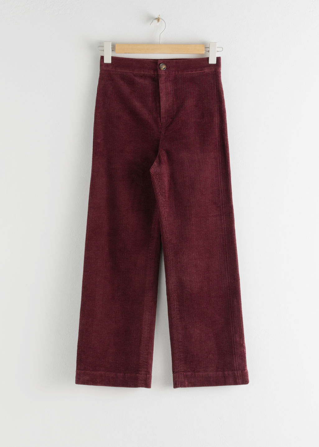 Front image of Stories relaxed corduroy trousers in red