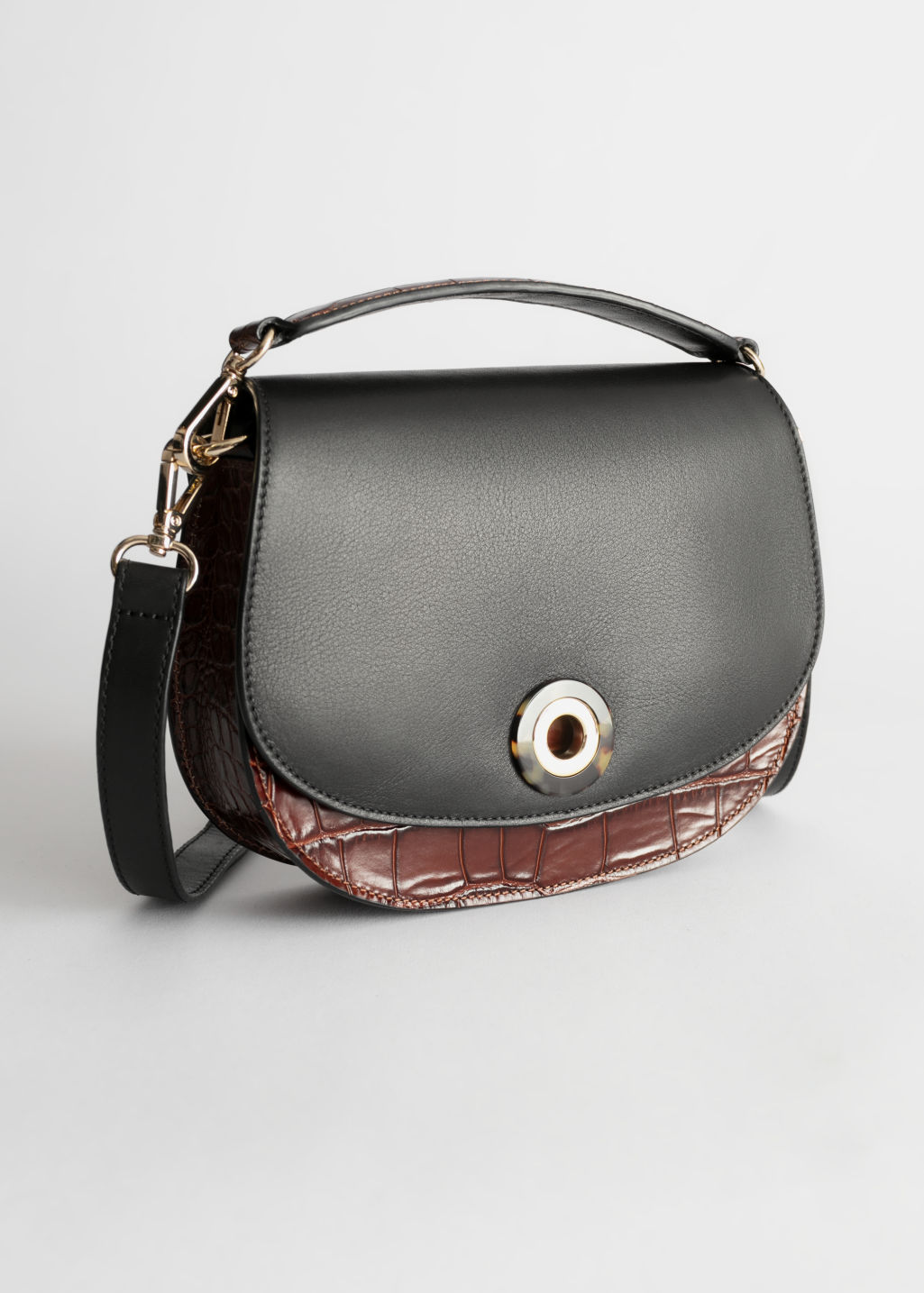 Front image of Stories tortoise eyelet croc small bag in black