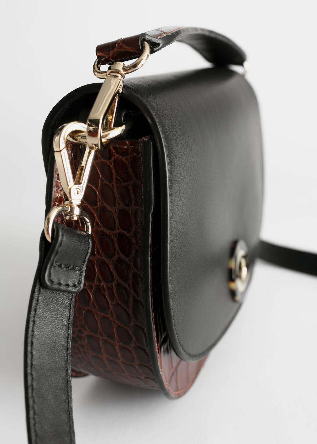 Back image of Stories tortoise eyelet croc small bag in black