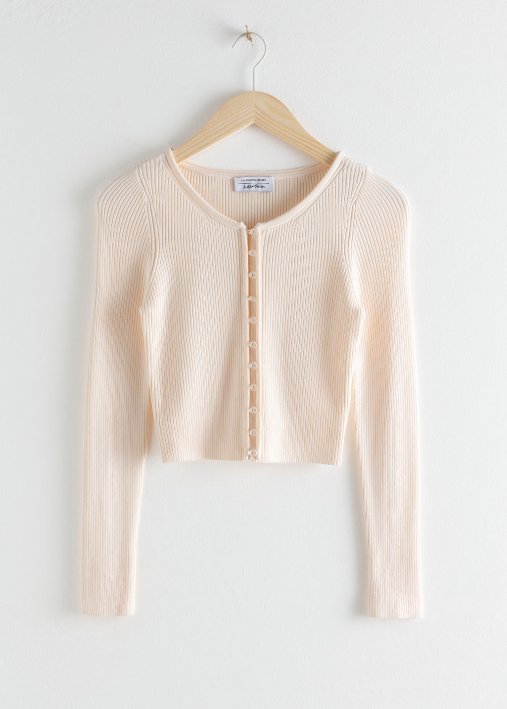 Front image of Stories ribbed cropped cardigan top in white
