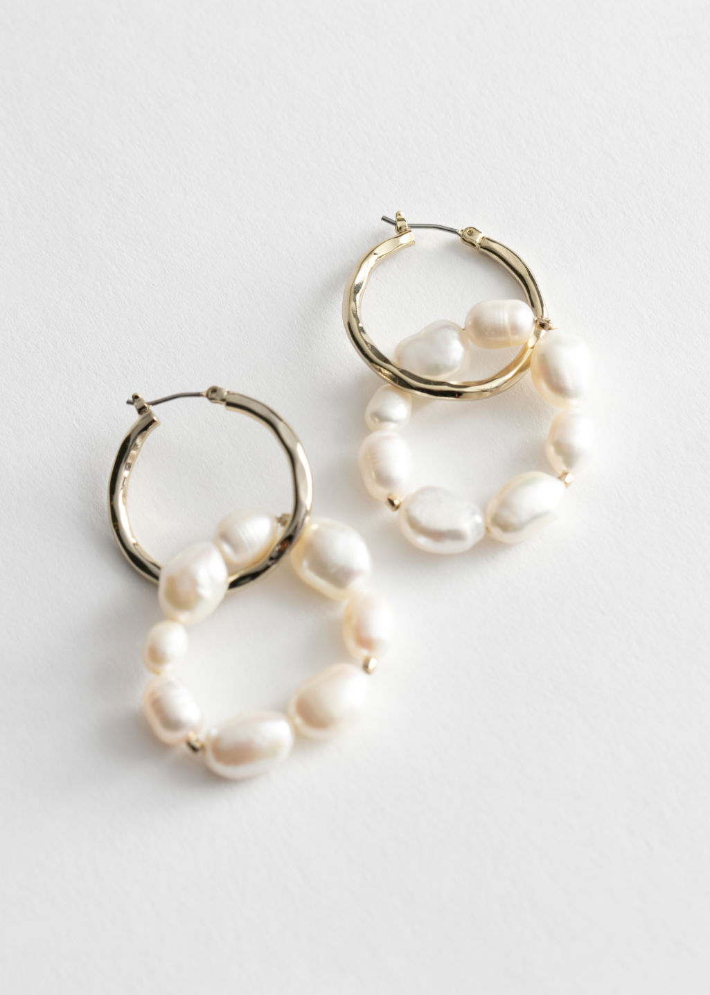 Front image of Stories pearl bead double hoop earrings in gold