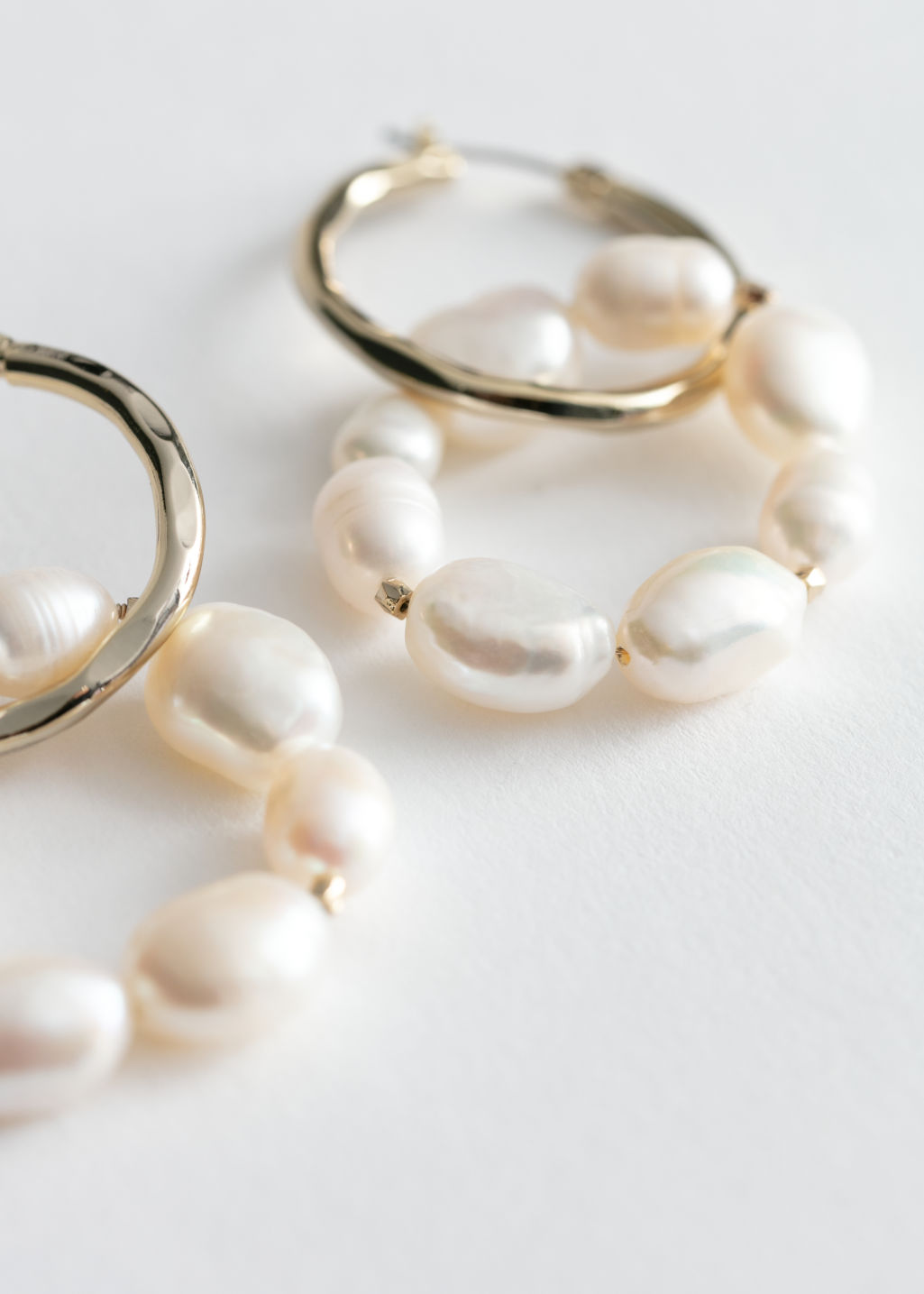 Back image of Stories pearl bead double hoop earrings in gold