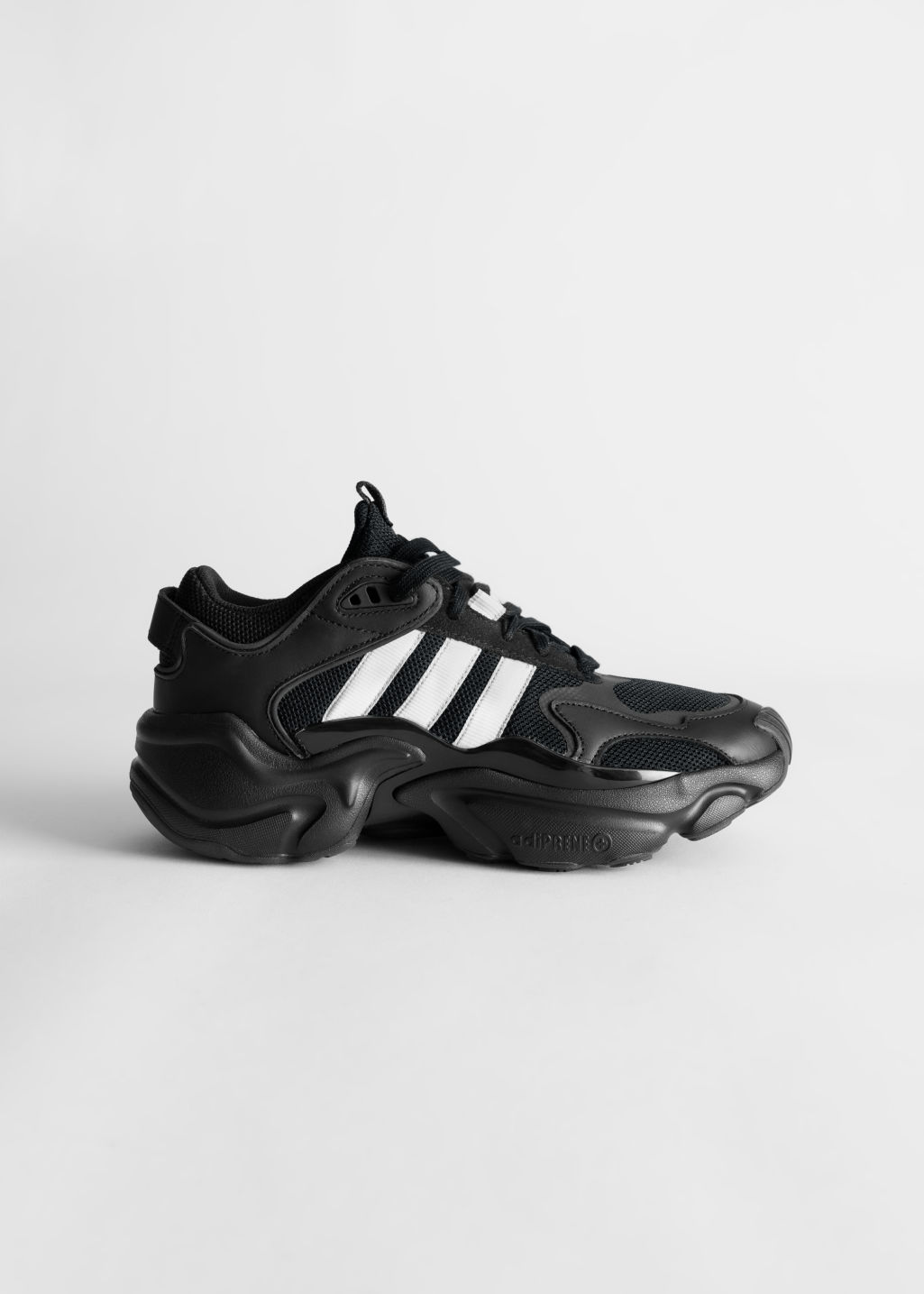 Front image of Stories adidas magmur in black