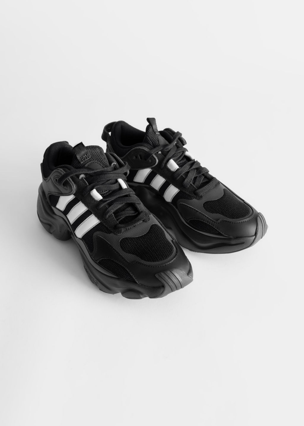 Back image of Stories adidas magmur in black