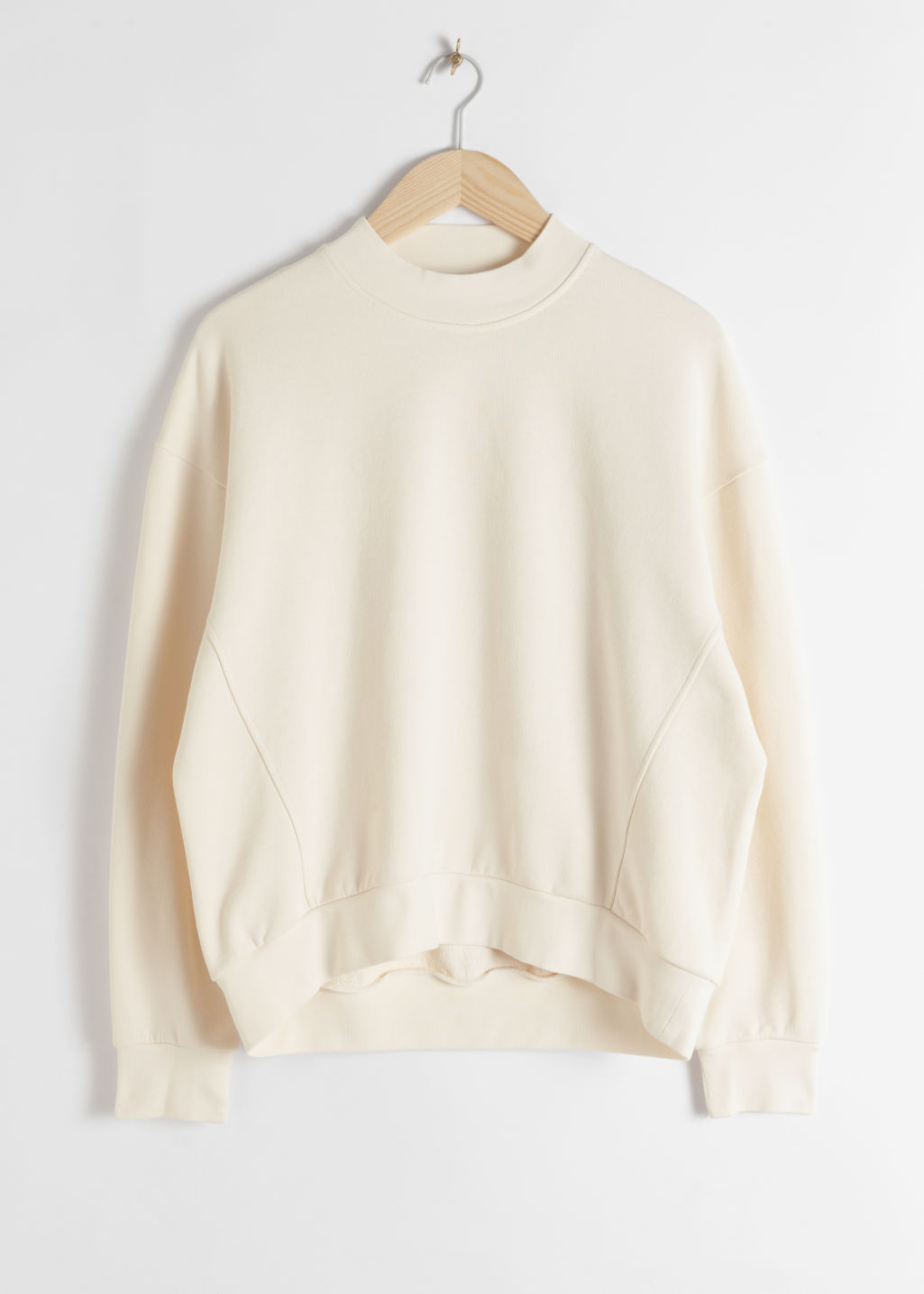StillLife Front Image of Stories Organic Cotton Mock Neck Sweater in White