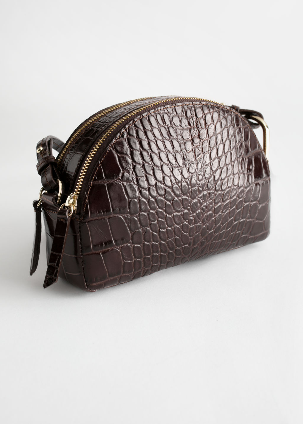 Front image of Stories half moon croc embossed crossbody bag in brown
