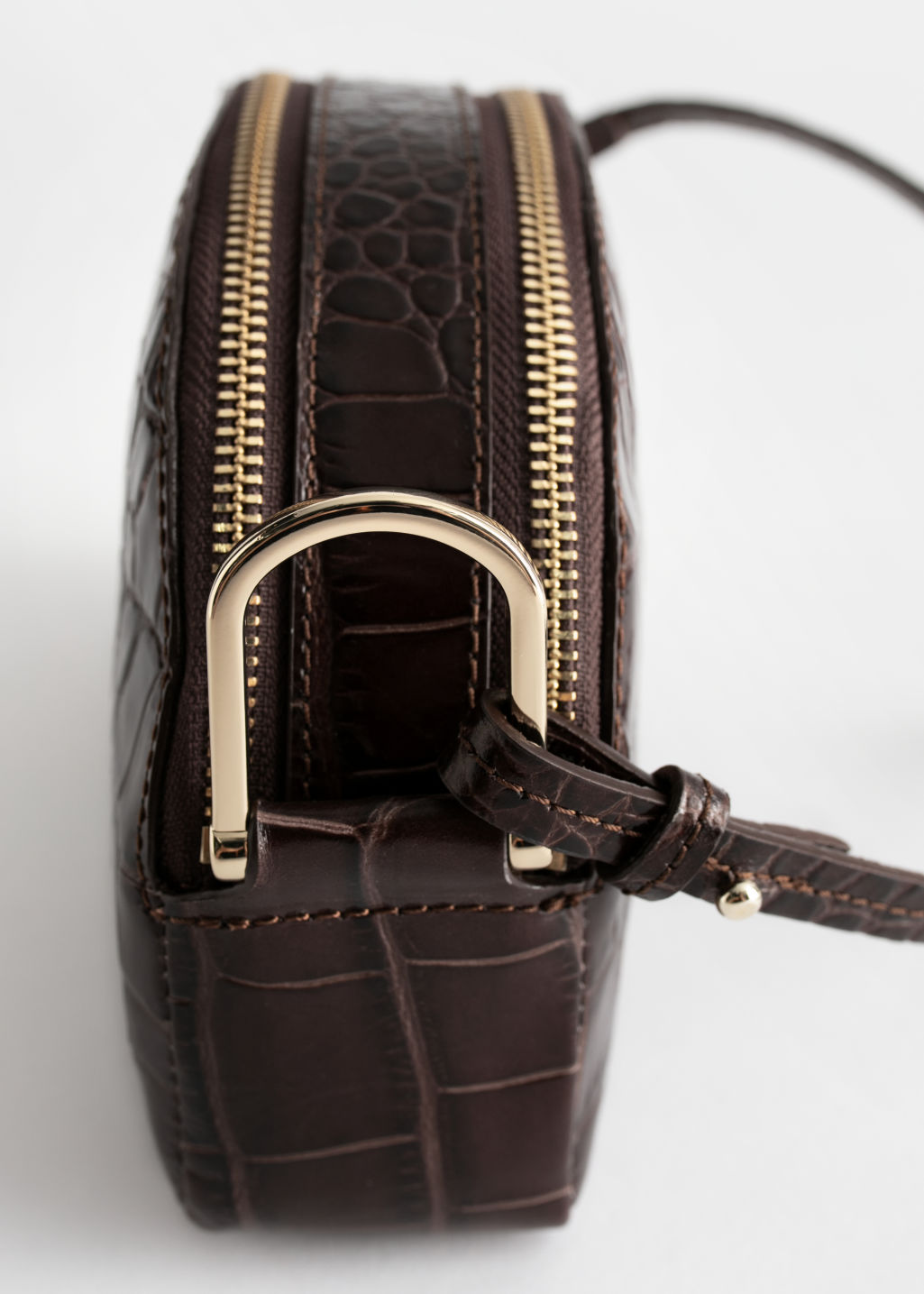 Back image of Stories half moon croc embossed crossbody bag in brown