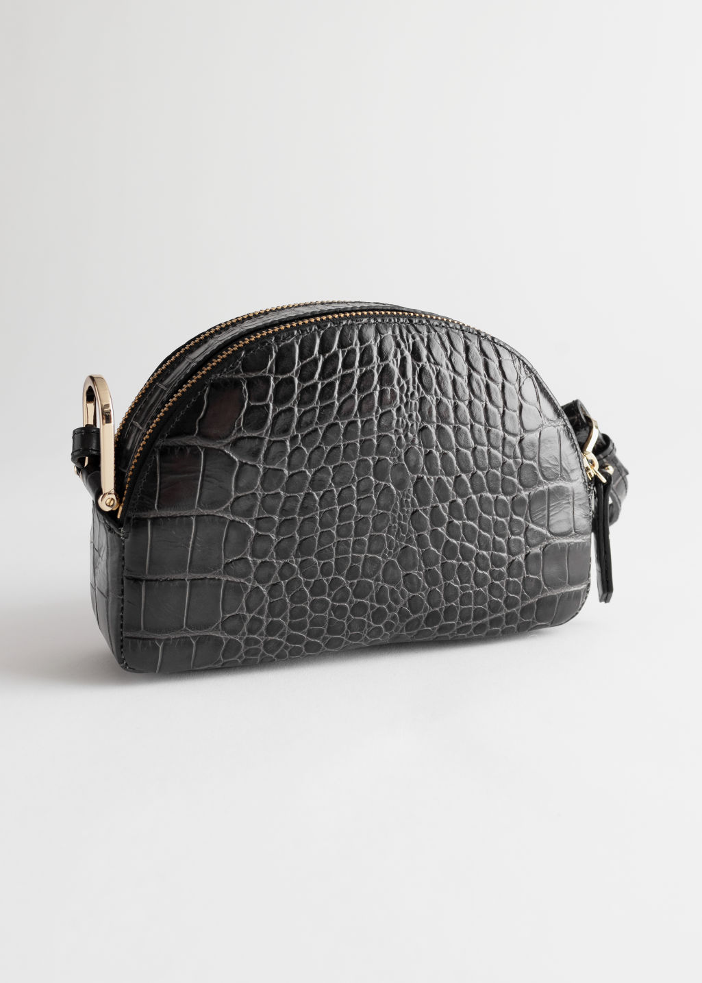 StillLife Front Image of Stories Half Moon Croc Embossed Crossbody Bag in Grey
