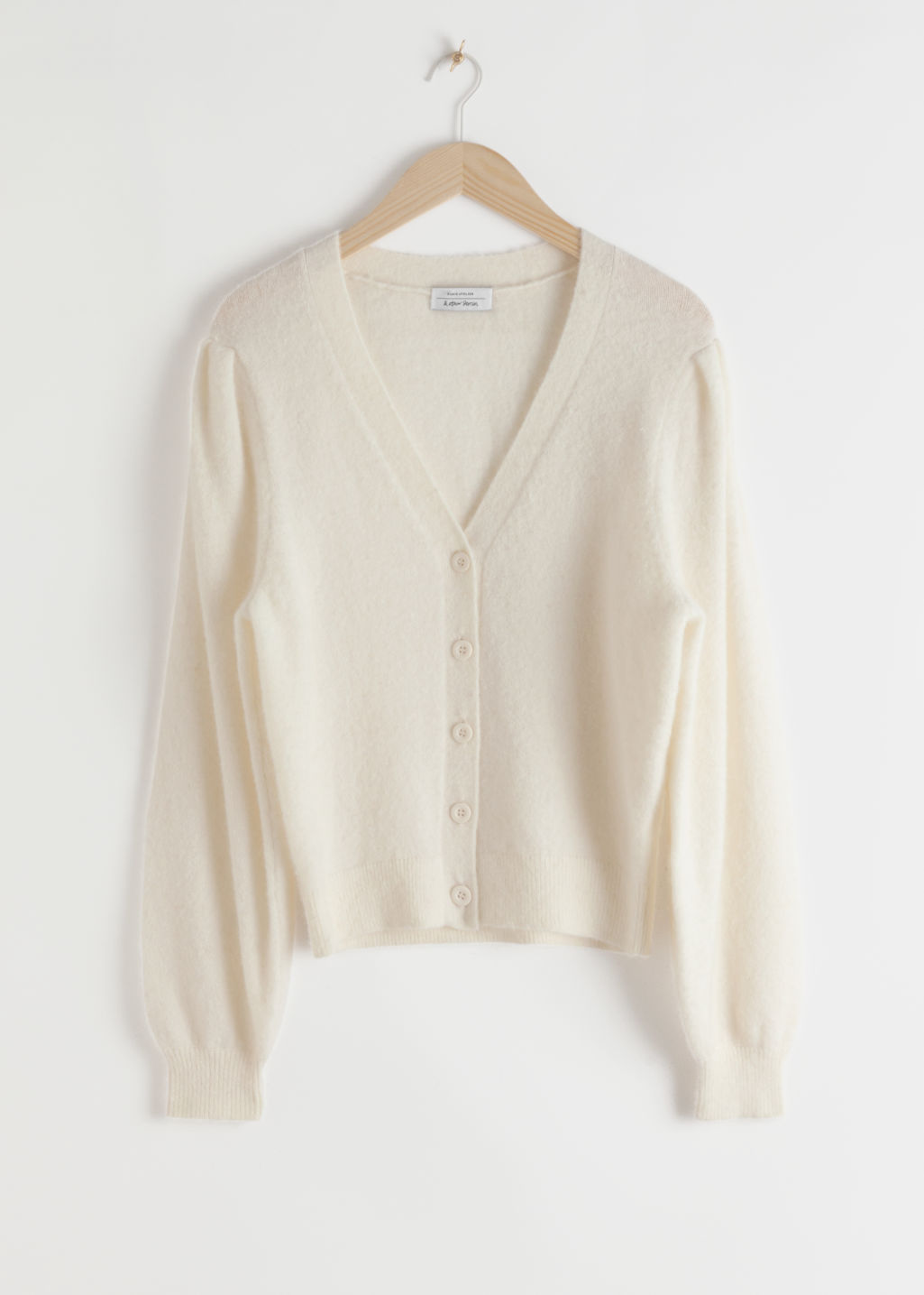 Front image of Stories wool blend puff shoulder cardigan in white