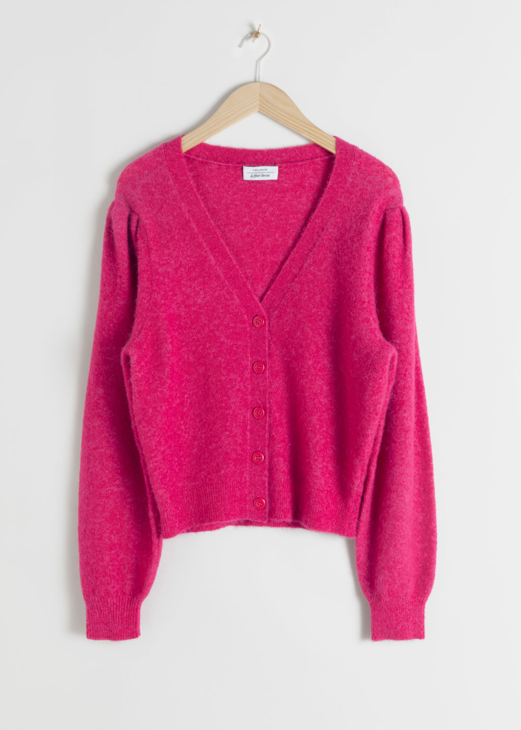 Front image of Stories wool blend puff shoulder cardigan in pink