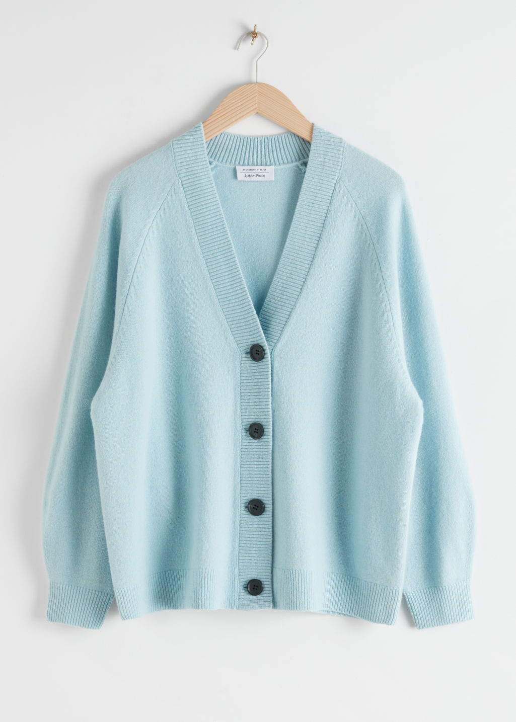 Front image of Stories oversized wool cardigan in blue