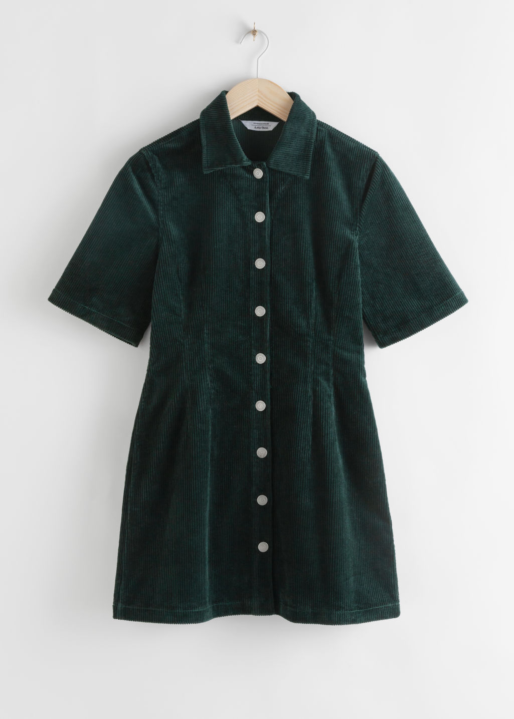 Front image of Stories corduroy button up mini dress in green