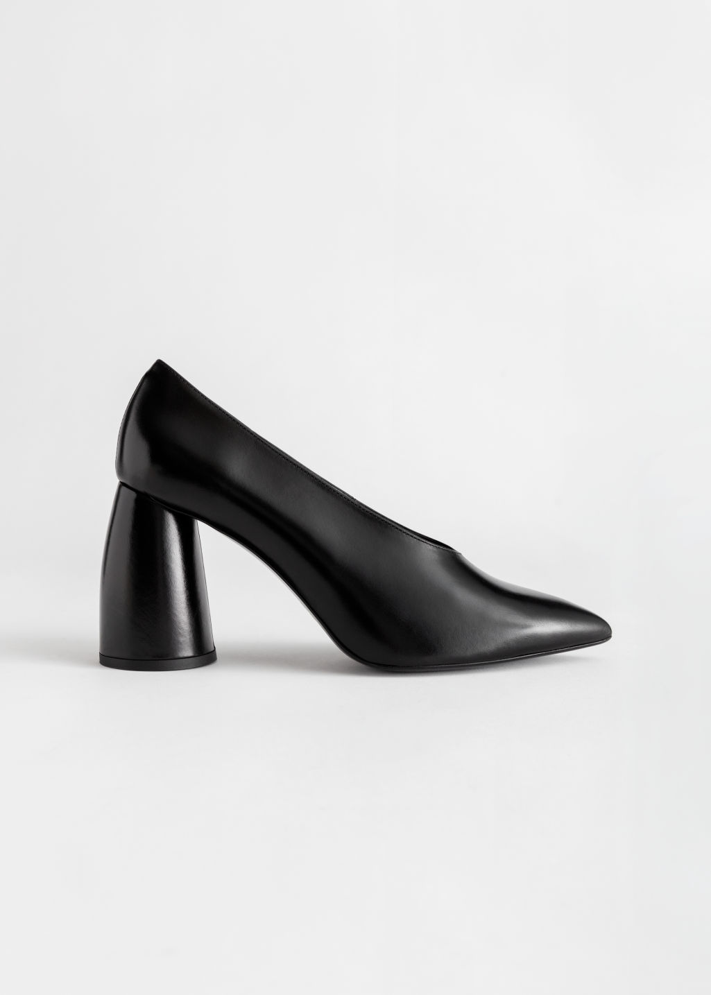 Front image of Stories flared block heel leather pumps in black