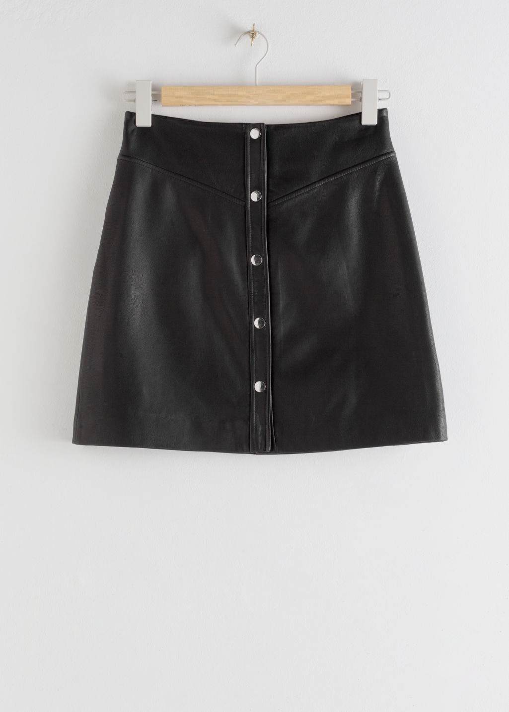 StillLife Front Image of Stories Leather Snap Button Mini Skirt in Black
