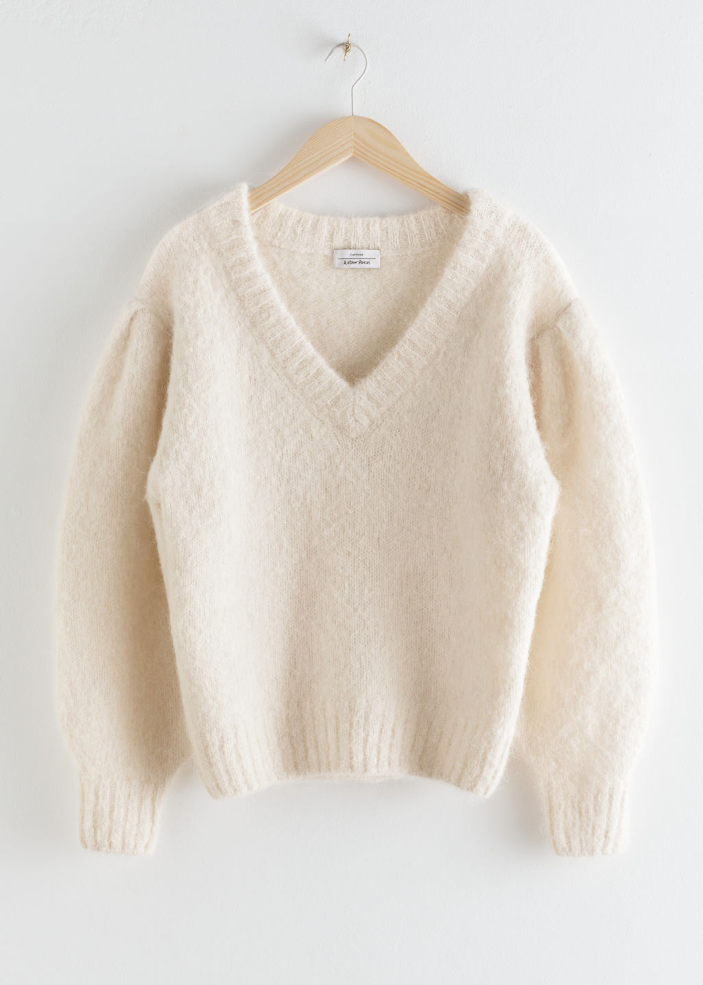 StillLife Front Image of Stories Oversized Puff Sleeve V-Neck Sweater in White
