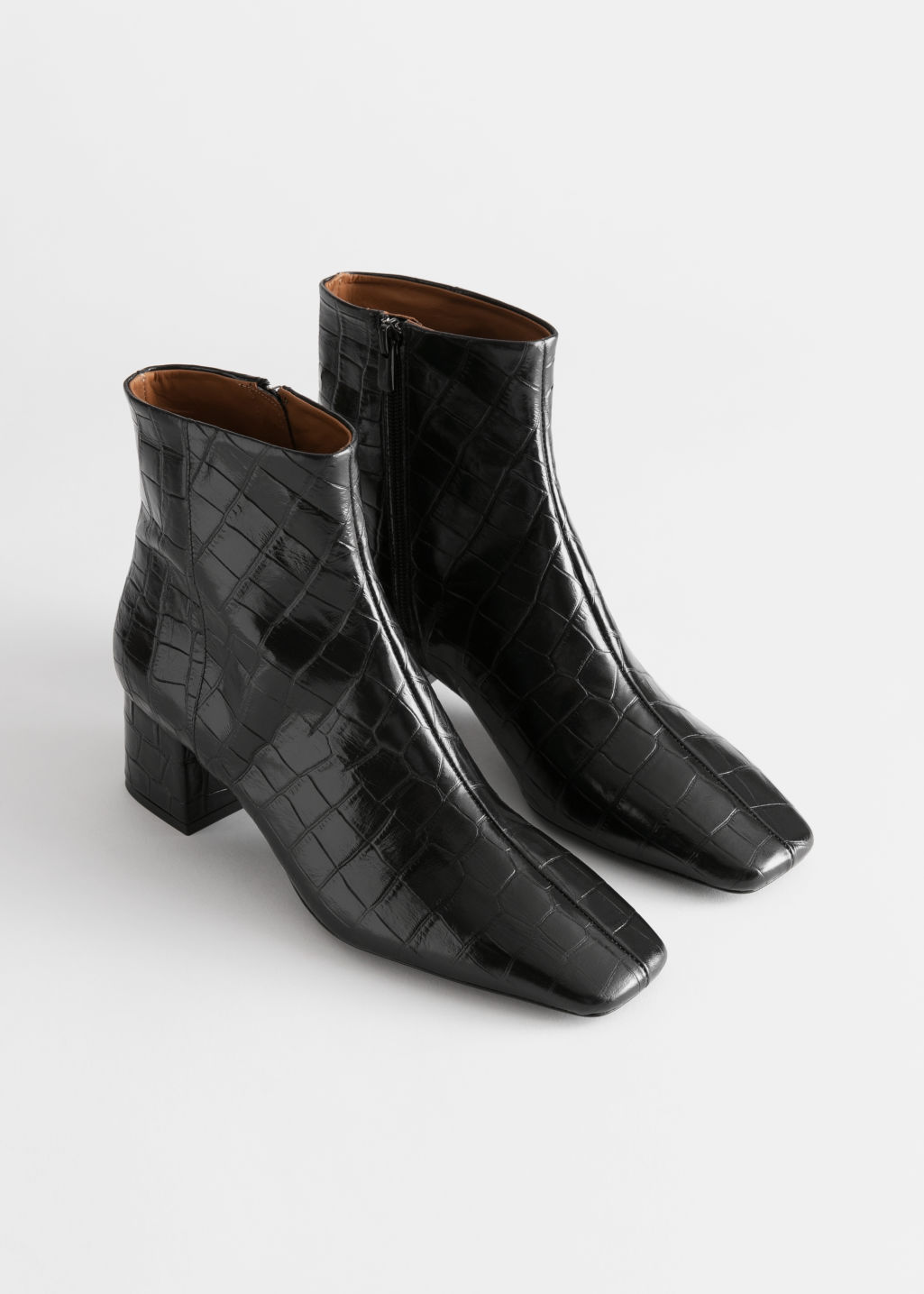 Front image of Stories croc embossed square toe boots in black