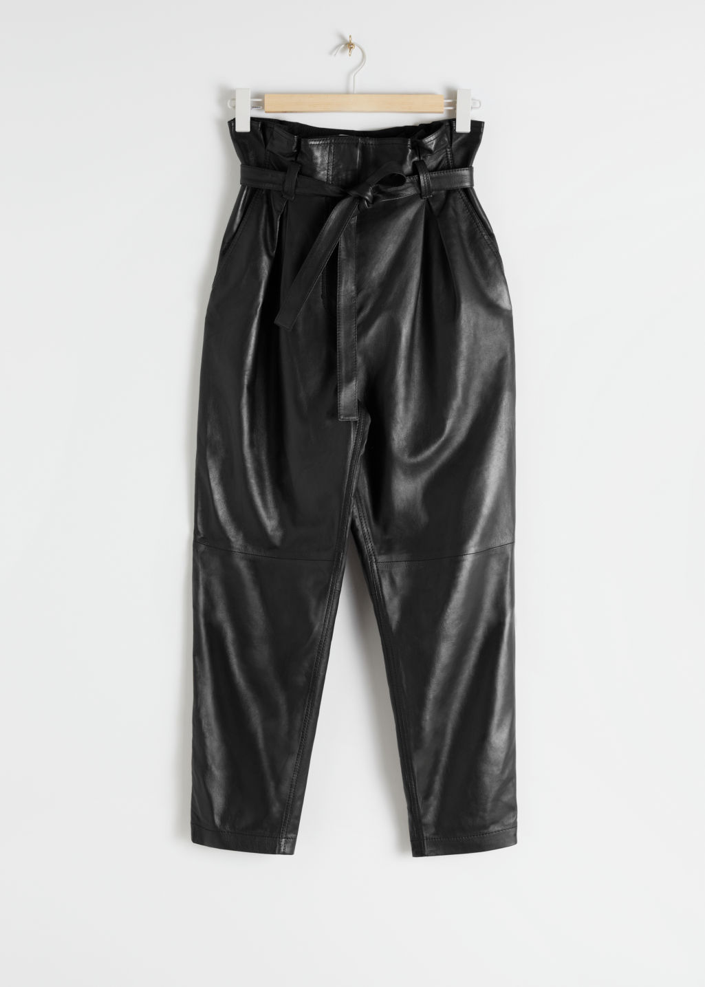 Front image of Stories paperbag waist leather trousers in black