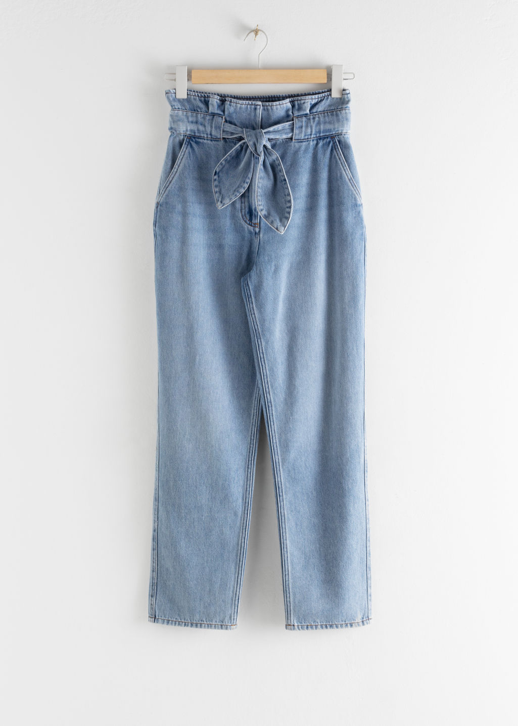 Front image of Stories belted paperbag waist jeans in blue