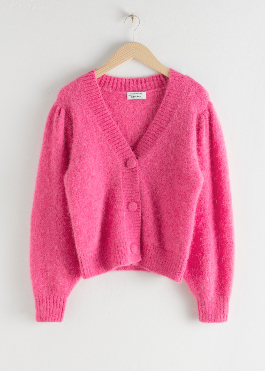 Front image of Stories puff sleeve cropped cardigan in pink