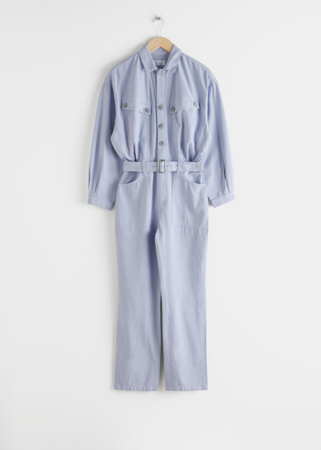 Front image of Stories belted organic cotton utility jumpsuit in blue