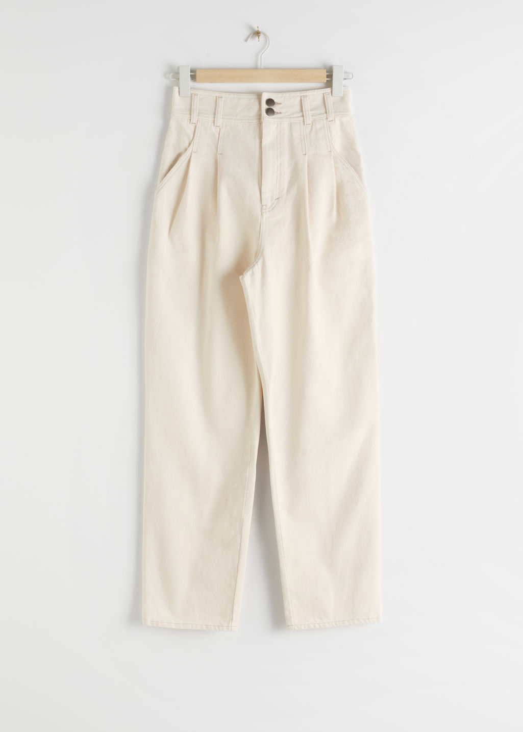 Front image of Stories high rise pleated organic cotton jeans in white