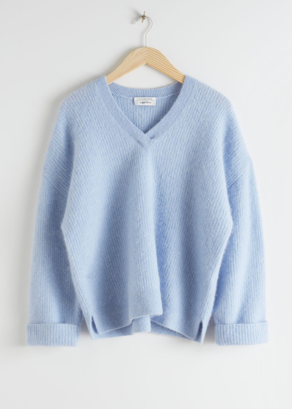 Front image of Stories oversized ribbed alpaca blend sweater in blue